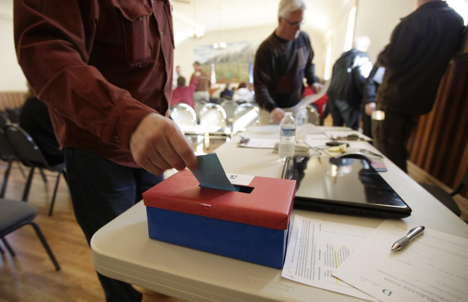 A voter casts his ballot at a Nevada Republican Caucus meeting, Saturday, Feb. 4, 2012, in Genoa, Nev. (AP Photo/Ted S. Warren)