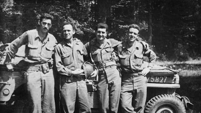 """This image released by The Weinstein Company shows author J.D. Salinger, left, after the Normandy invasion with his fellow counterintelligence officers from the film """"Salinger."""" Harvey Weinstein is developing a feature film about J.D. Salinger to follow the recently released documentary. The Weinstein Co. announced the plans Wednesday, Sept. 18, saying the film will focus on the author's life between his World War II service and the publication of """"Catcher in the Rye."""" The film will examine """"the effects war can have on an artist."""" (AP Photo/The Weinstein Company)"""