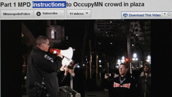 This May 17, 2012, image made of the Minneapolis Police Department YouTube Channel shows a computer screen displaying a video of a Minneapolis police officer giving instructions to protesters at an Occupy Minnesota protest in Minneapolis. Minneapolis police first used their YouTube channel after protesters posted video accusing officers of brutality disrupting a demonstration with no warning to disperse. Police filmed the arrests and soon posted their own video showing warnings were given. (AP Photo/Minneapolis Police Department YouTube Channel)