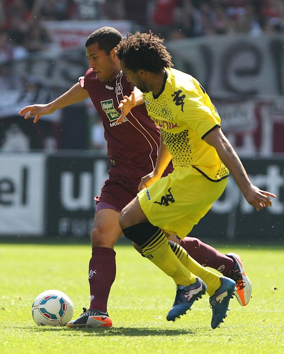 Dortmund's Defender Patrick Owomoyela (R) And Kaiserslautern's US Midfielder Andrew Wooten Vie For The Ball    AFP/Getty Images