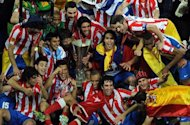 Atletico Madrid celebrate with the trophy after winning the UEFA Europa League final football match between Atletico Madrid and Athletic Bilbao at the National Arena stadium in Bucharest