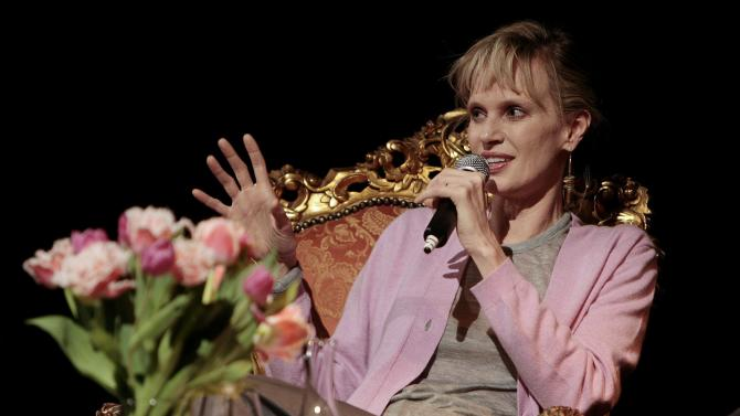 FILE - In this April 11, 2008, file photo, U.S. writer Siri Hustvedt answers questions during a reading in Zurich, Switzerland. The Americans have arrived in force for Britain's Booker literary prize. Five U.S.-based writers are on the 13-book long-list for the prestigious fiction award. The list, announced Wednesday, includes Americans Joshua Ferris, Karen Joy Fowler, Siri Hustvedt and Richard Powers, as well as Irish-American writer Joseph O'Neill. (AP Photo/Keystone/Eddy Risch, File)