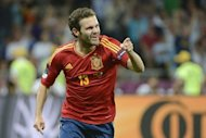 Spanish forward Juan Mata celebrates after scoring a goal during the Euro 2012 football championships final match Spain vs Italy at the Olympic Stadium in Kiev. Spain confirmed their status as one of the greatest national teams in football history by overwhelming Italy 4-0 in Sunday&#39;s Euro 2012 final in Kiev to retain their European crown