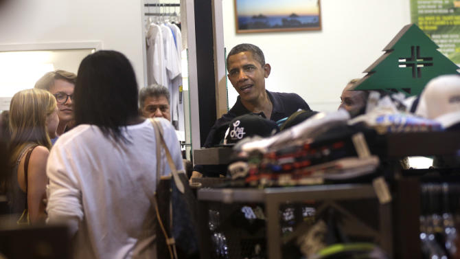 President Barack Obama greets patrons as he visits Island Snow for shave ice in Kailua, Hawaii, during his holiday vacation, Thursday, Jan 3, 2013. (AP Photo/Gerald Herbert)