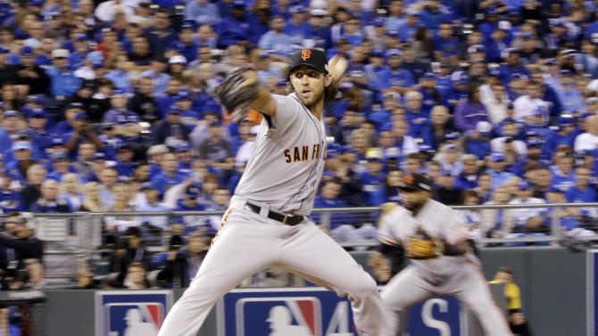 San Francisco Giants pitcher Madison Bumgarner throws during the fifth inning of Game 1 of baseball's World Series against the Kansas City Royals Tuesday, Oct. 21, 2014, in Kansas City, Mo. (AP Photo/David J. Phillip)