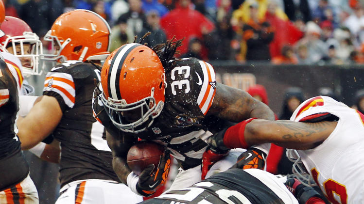 Cleveland Browns running back Trent Richardson (33) scores on a 1-yard touchdown carry in the fourth quarter of an NFL football game against the Kansas City Chiefs, Sunday, Dec. 9, 2012, in Cleveland. (AP Photo/Tony Dejak)