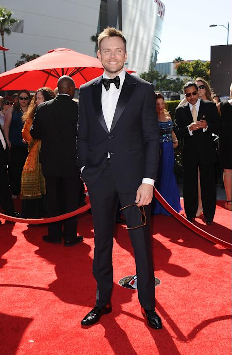 Joel McHale arrives at the 2013 Primetime Creative Arts Emmy Awards, on Sunday, September 15, 2013 at Nokia Theatre L.A. Live, in Los Angeles, Calif. (Photo by Scott Kirkland/Invision for Academy of T