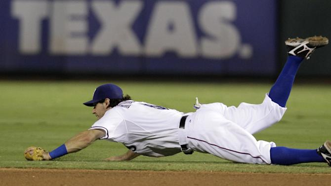 Texas Rangers second baseman Ian Kinsler is unable to reach a single by Cleveland Indians' Grady Sizemore in the fourth inning of a baseball game Tuesday, Sept. 13, 2011, in Arlington, Texas. (AP Photo/Tony Gutierrez)