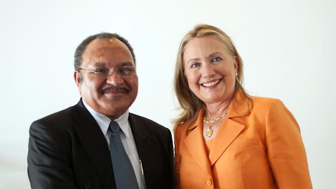 U.S. Secretary of State Hillary Rodham Clinton, right, shakes hands with Papua New Guinea Prime Minister Peter Charles Paire O'Neill after a bilateral meeting during the Pacific Island Forum Post-Forum Dialogue in Rarotonga, Cook Islands, Friday, Aug. 31, 2012. (AP Photo/Jim Watson, Pool)