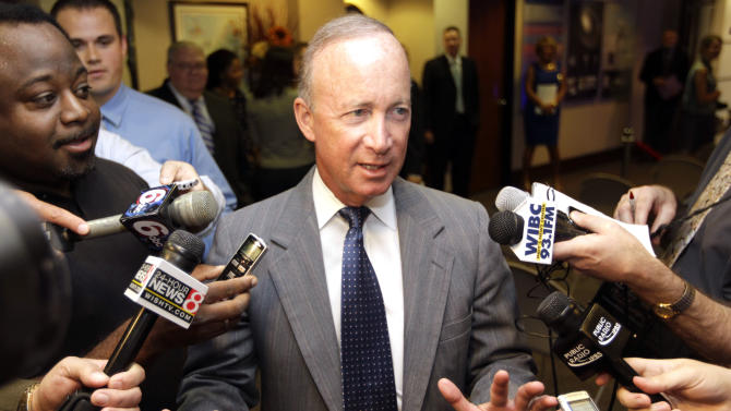 Indiana Gov. Mitch Daniels declines to answer questions on reports that he will be named president of Purdue University following an economic developement announcement in Indianapolis, Wednesday, June 20, 2012.  (AP Photo/Michael Conroy)