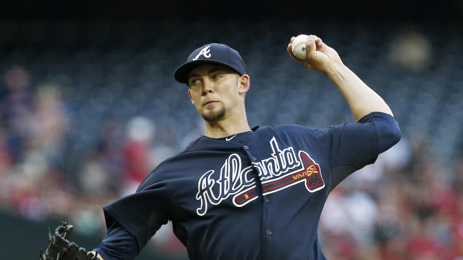 Atlanta Braves' Mike Minor throws against the Arizona Diamondbacks during the first inning of a baseball game, on Monday, May 13, 2013, in Phoenix. (AP Photo/Ross D. Franklin)