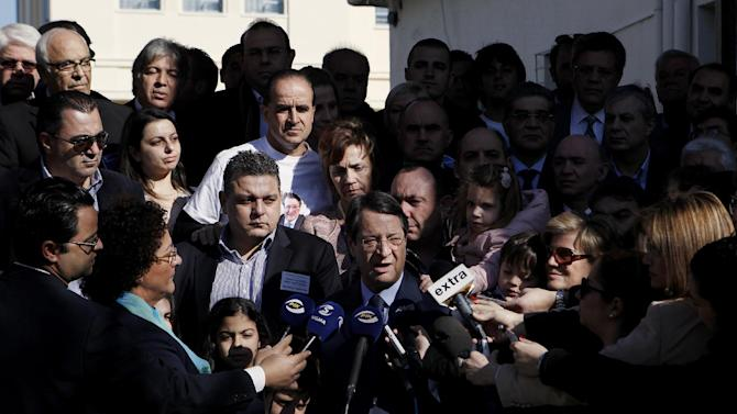 Right-wing opposition leader and presidential candidate Nicos Anastasiades speaks to the media after voting in the Presidential election in southern port city of Limassol, Cyprus, Sunday, Feb. 17, 2013. Cypriots vote for a new president to guide them through a severe economic crisis that has the country joining other troubled European nations in seeking international rescue money to pull it back from the brink of bankruptcy. (AP Photo/Petros Karadjias)