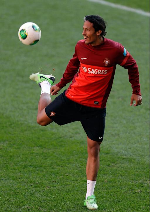 Portugal's Bruno Alves plays with a ball during a training session Sunday, Nov. 17 2013, at the Luz stadium in Lisbon. Portugal will play Sweden Tuesday in a World Cup qualifying playoff second-leg so