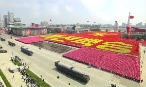 In this image made from video, military vehicles parade…