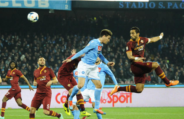 Napoli's Federico Fernndez and AS Roma Mehdi Benatia, right, jump for the ball during a Serie A soccer match between Napoli and Roma, at the San Paolo stadium in Naples, Italy, Sunday, March 9, 20