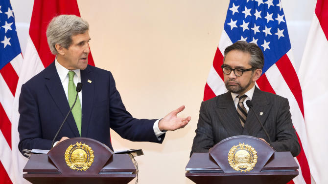 U.S. Secretary of State John Kerry, left, speaks during a news conference with Indonesian Foreign Minister Marty Natalegawa at the Pancasila on Monday, Feb. 17, 2014, in Jakarta. (AP Photo/ Evan Vucci, Pool)