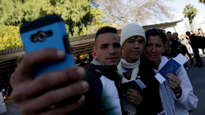 Cuban migrants take a selfie with their passports after arriving by plane from Costa Rica to Nuevo Laredo