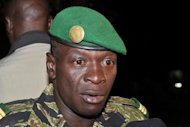 Malian junta leader captain Amadou Sanogo speaks after his meeting with Burkina Faso&#39;s Foreign Minister Djibril Bassole at the Kati military camp near Bamako. Sanogo on Saturday ordered the army &quot;not to prolong the fighting&quot; in Gao, a move that leaves the main northern town open to the rampant Toureg rebels