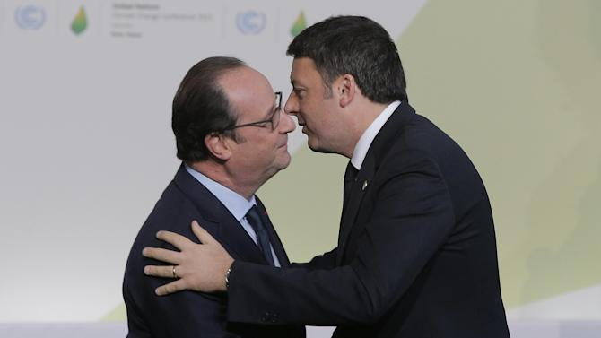 French President Francois Hollande, left, greets Italy's Prime Minister Matteo Renzi as he arrives for the COP21, United Nations Climate Change Conference, in Le Bourget, outside Paris, Monday, Nov. 30, 2015. (AP Photo/Christophe Ena, Pool)