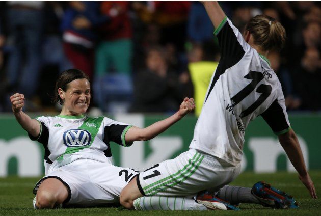 Wolfsburg's Muller celebrates scoring a penalty against Olympique Lyon with Popp during their women's UEFA Champions League final soccer match in London