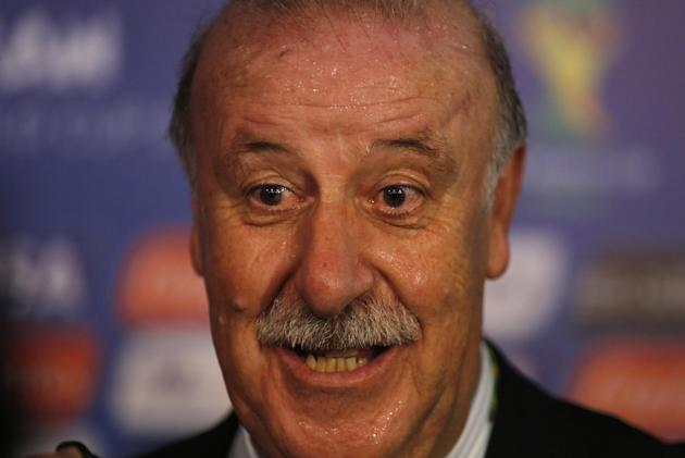 Spain head coach Vicente Del Bosque answers journalists' questions after the draw ceremony for the 2014 soccer World Cup in Costa do Sauipe near Salvador, Brazil, Friday, Dec. 6, 2013