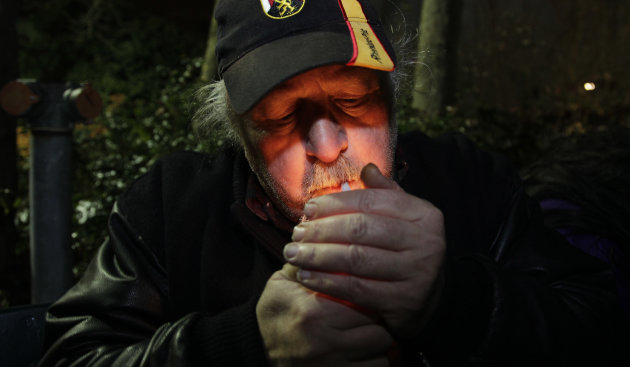 Mike Momany smokes marijuana, Thursday, Dec. 6, 2012, just after midnight at the Space Needle in Seattle. Possession of marijuana became legal in Washington state at midnight, and several hundred peop