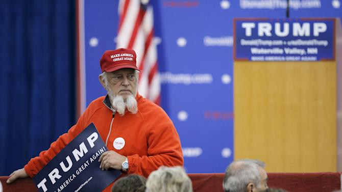 A supporter waits for U.S. Republican presidential candidate Donald Trump at a campaign rally in Waterville Valley