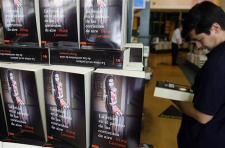 "A customer browses a copy of Swedish author Stieg Larsson's latest book,""The Girl Who Kicked the Hornets' Nest"", at a Madrid bookstore"