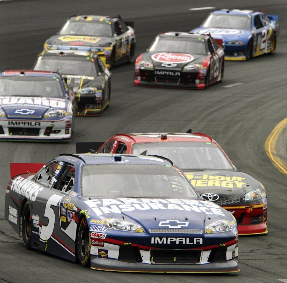 Kasey Kahne (5) takes the lead in a restart during the NASCAR Sprint Cup Series auto race, Sunday July 15, 2012, at New Hampshire Motor Speedway in Loudon, N.H. Kahne won the race. (AP Photo/Jim Cole)