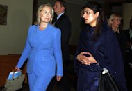 U.S. Secretary of State Hillary Rodham Clinton, left, walks with Pakistan's Foreign Minister Hina Rabbani Khar, right, at the 18th ASEAN Regional Forum in Nusa Dua, Bali, Indonesia, Saturday, July 23, 2011. (AP Photo/Firdia Lisnawati)