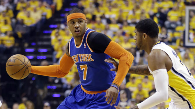 New York Knicks' Carmelo Anthony (7) tries to drive past Indiana Pacers' Paul George during the first half of Game 3 of an Eastern Conference semifinal NBA basketball playoff series in Saturday, May 11, 2013, in Indianapolis. (AP Photo/Darron Cummings)
