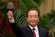 China's Premier Wen Jiabao makes a toast during the 63rd National Day reception at the Great Hall of the People in Beijing in September 2012. The relatives of Wen have controlled assets worth at least $2.7 billion, the New York Times said in a report that comes as the Communist Party strives to clean house before a pivotal handover of power