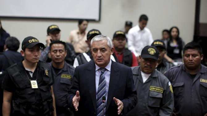 Former President Otto Perez leaves after a hearing at the Supreme Court of Justice in Guatemala City