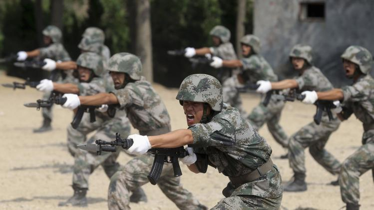 Members of PLA coastal defence force shout as they practise during a drill to mark the 87th Army Day at a military base in Qingdao