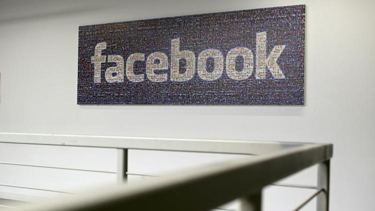 The Facebook logo is pictured in the Facebook headquarters in Menlo Park
