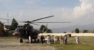 A wounded Pakistani girl, Malala Yousufzai, is moved to a helicopter to be taken to Peshawar for treatment in Mingora, Swat Valley, Pakistan, Tuesday, Oct. 9, 2012. A Taliban gunman walked up to a bus taking children home from school in Pakistans volatile Swat Valley Tuesday and shot and wounded a 14-year-old activist known for championing the education of girls and publicizing atrocities committed by the Taliban, officials said.(AP Photo/Sherin Zada)
