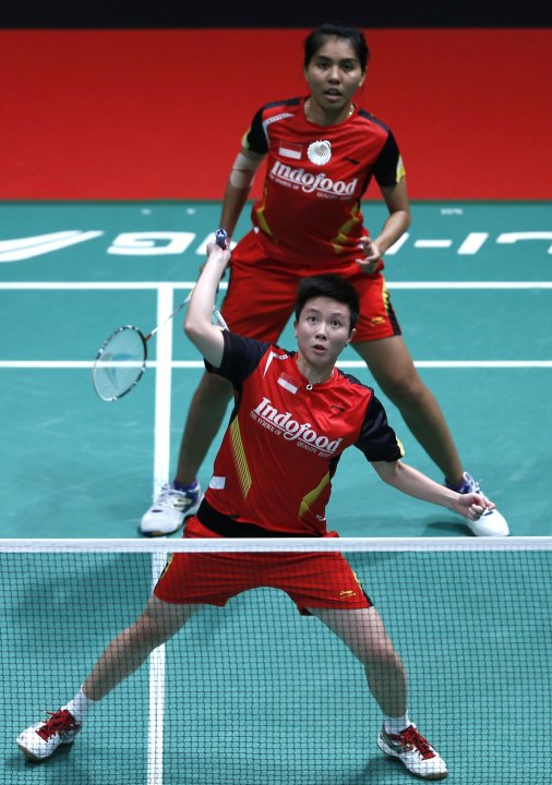 Indonesia's Lilyana with partner Maheswari plays a shot during their women's doubles match against China's Yu and Wang in Kuala Lumpur