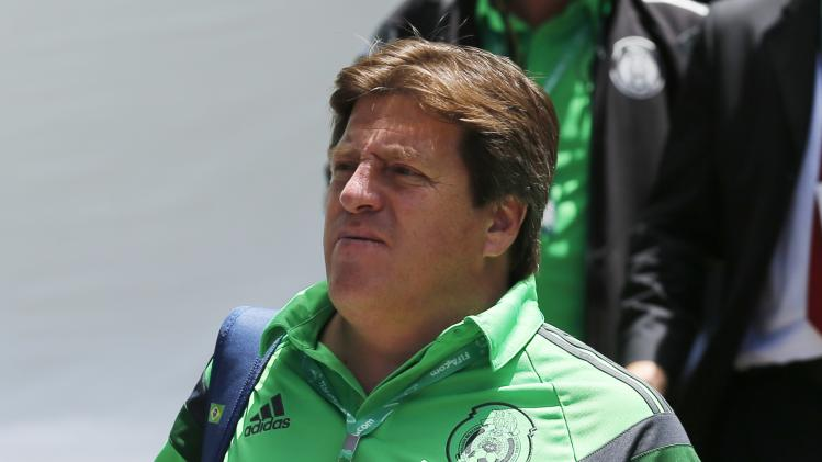 Mexico's coach Herrera walks before an official photo at the Team Workshop for the 2014 World Cup in Florianopolis