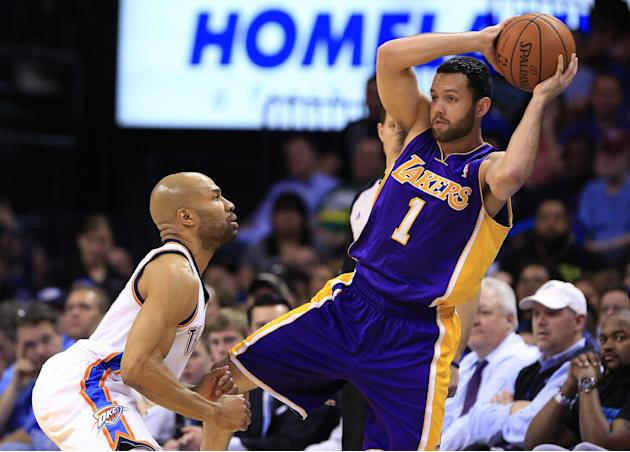 Los Angeles Lakers guard Jordan Farmar (1) looks to pass as Oklahoma City Thunder guard Derek Fisher (6) defends during the third quarter of an NBA basketball game in Oklahoma City, Thursday, March 13