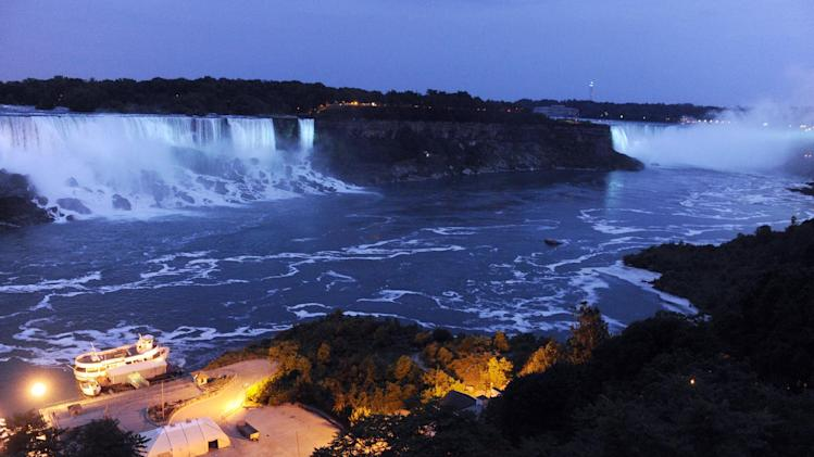 The Canadian side of the American Falls and Horseshoe Falls are illuminated in blue to celebrate the birth of the Duke and Duchess of Cambridge's son, Monday, July 22, 2013, in Niagara Falls, Canada. (AP Photo/Gary Wiepert)