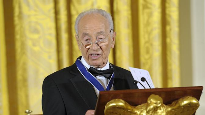 Israeli President Shimon Peres speaks after being presented with the Presidential Medal of Freedom at a dinner in the East Room of the White House in Washington, Wednesday, June 13, 2012. (AP Photo/Susan Walsh)