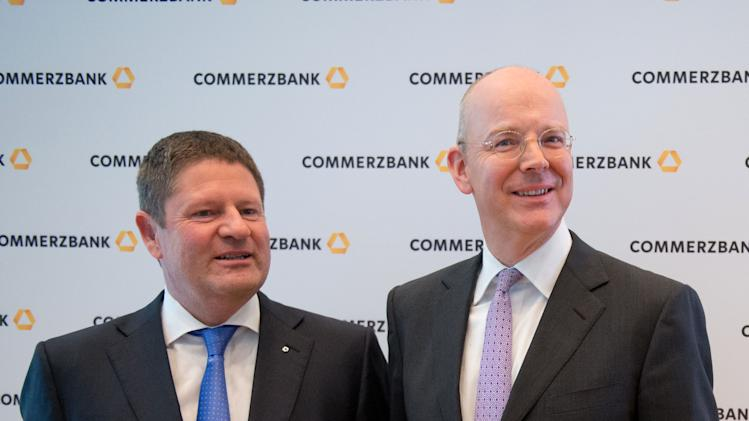 "Martin Blessing , CEO of Germany's Commerzbank , right,  and CFO  Stephan Engels arrive for a balance press conference in Frankfurt, Germany , Friday Feb. 15, 2013.  Germany's Commerzbank says it's making progress in reshaping its business but still has ""a long way to go"" as higher shipping loan losses and low interest rates continue to squeeze profits.  The bank provided detail Friday on its fourth-quarter earnings announced Feb. 4. It lost 716 million euro (US$954 million) largely due to one-time losses of 185 million euro on its sale of Bank Forum in Ukraine and 560 million euro in tax accounting charges. For all of 2012, net profit was a meager 6 million euro as loan losses increased and interest earnings shrank. (AP Photo/dpa, Boris Roessler)"