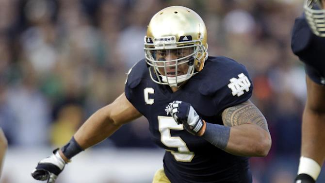 FILE - In this Oct. 20, 2012, file photo, Notre Dame linebacker Manti Te'o chases the action during the second half of an NCAA college football game against the BYU in South Bend, Ind. Te'o is a finalist for the Heisman Trophy. (AP Photo/Michael Conroy, File)