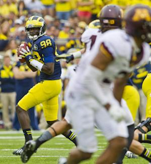 No. 19 Michigan pulls away to rout Minnesota 42-13