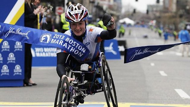 Tatyana McFadden of the U.S. crosses the finish line to win the women's wheelchair division of the 117th Boston Marathon in Boston (Reuters)