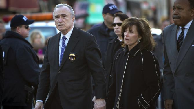 New York Police Commissioner Bill Bratton arrives with wife Rikki Klieman for the wake for NYPD officer Rafael Ramos at Christ Tabernacle Church in the Queens borough of New York