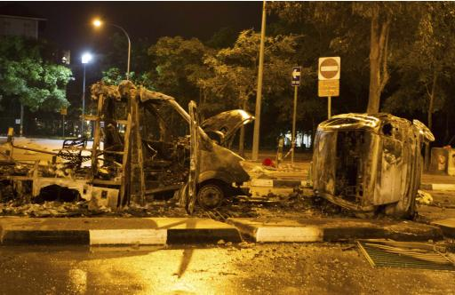 The burnt shells of vehicles are pictured along Race Course Road following a riot near Singapore's Little India district