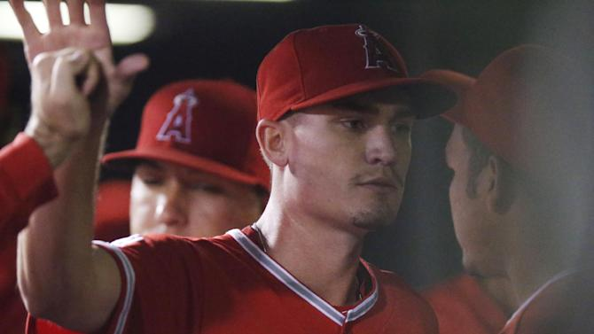 Los Angeles Angels starting pitcher Andrew Heaney returns to the dugout after being removed following back-to-back singles by the Colorado Rockies in the eighth inning of a baseball game Tuesday, July 7, 2015, in Denver. The Angels won 10-2. (AP Photo/David Zalubowski)