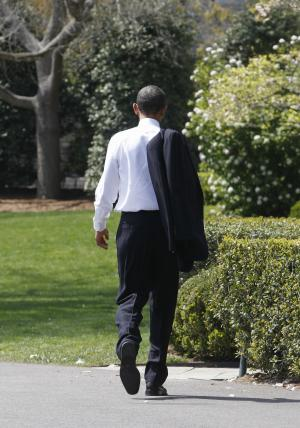 President Obama walks back towards the Rose Garden of the White House in Washington, Monday, April 11, 2011,  after he met students from Altona Middle School in Longmont, Colo., on the South Portico. Obama received a letter from a mother at the school worried that her son's trip to Washington would be canceled if there were to be a government shutdown. (AP Photo/Charles Dharapak)