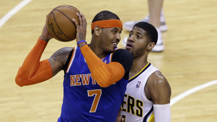 New York Knicks forward Carmelo Anthony (7) looks to get past Indiana Pacers forward Paul George during the first quarter of Game 6 of the Eastern Conference semifinal NBA basketball playoff series in Indianapolis, Saturday, May 18, 2013. (AP Photo/Michael Conroy)